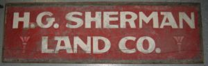 H. G. Sherman Land Co. Hand-painted sign on tin